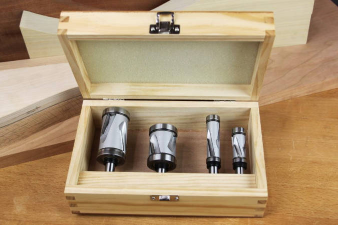 Mega Flush Trim router bit set, using compression spiral cutting geometry and large bit diameter to produce clean cuts